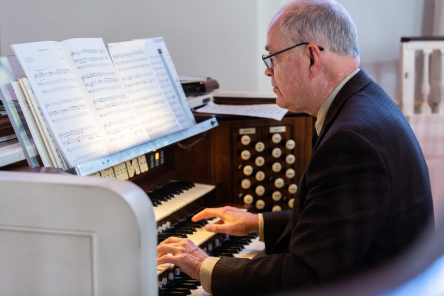 The organist plays the organ during worship