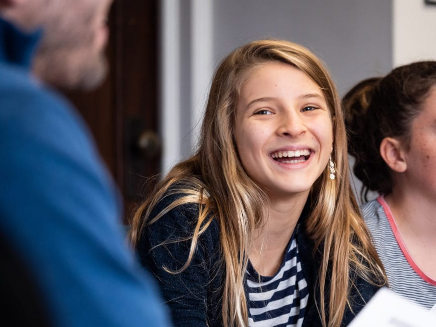 A girl smiles in church youth group