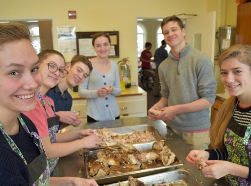 Youth prepare food for SouperBowl of Caring lunch