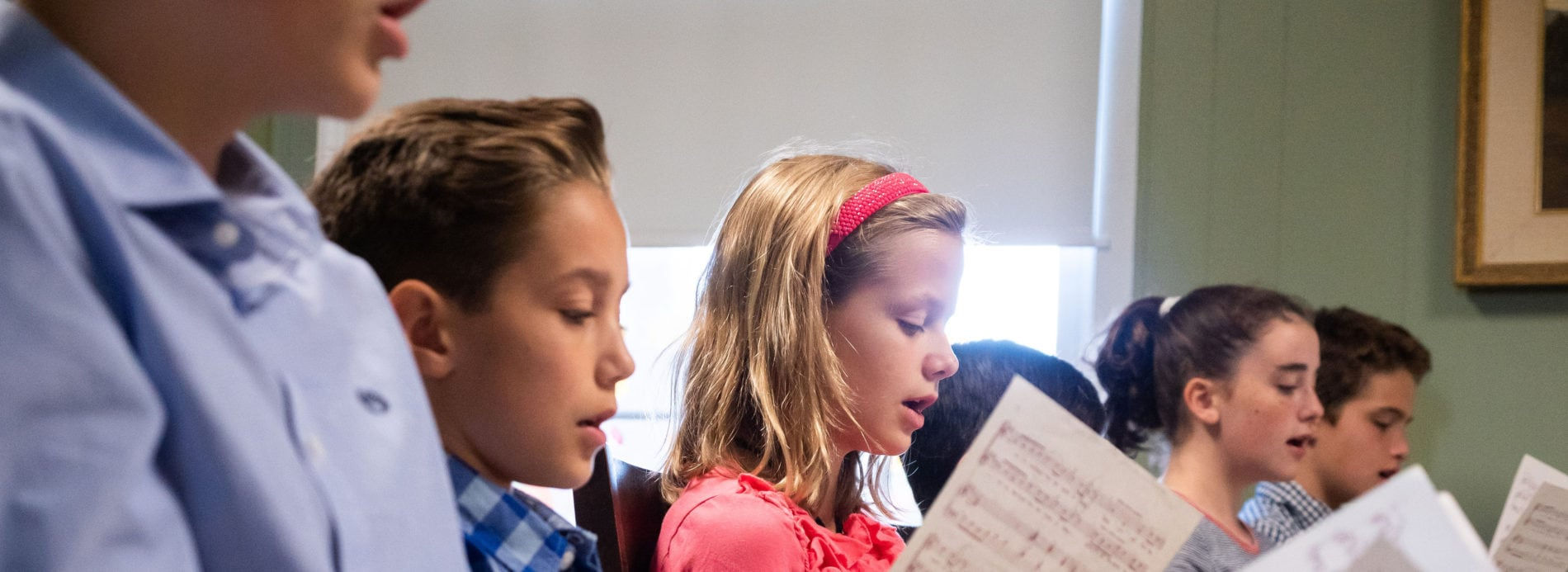 children rehearse for the children's choir