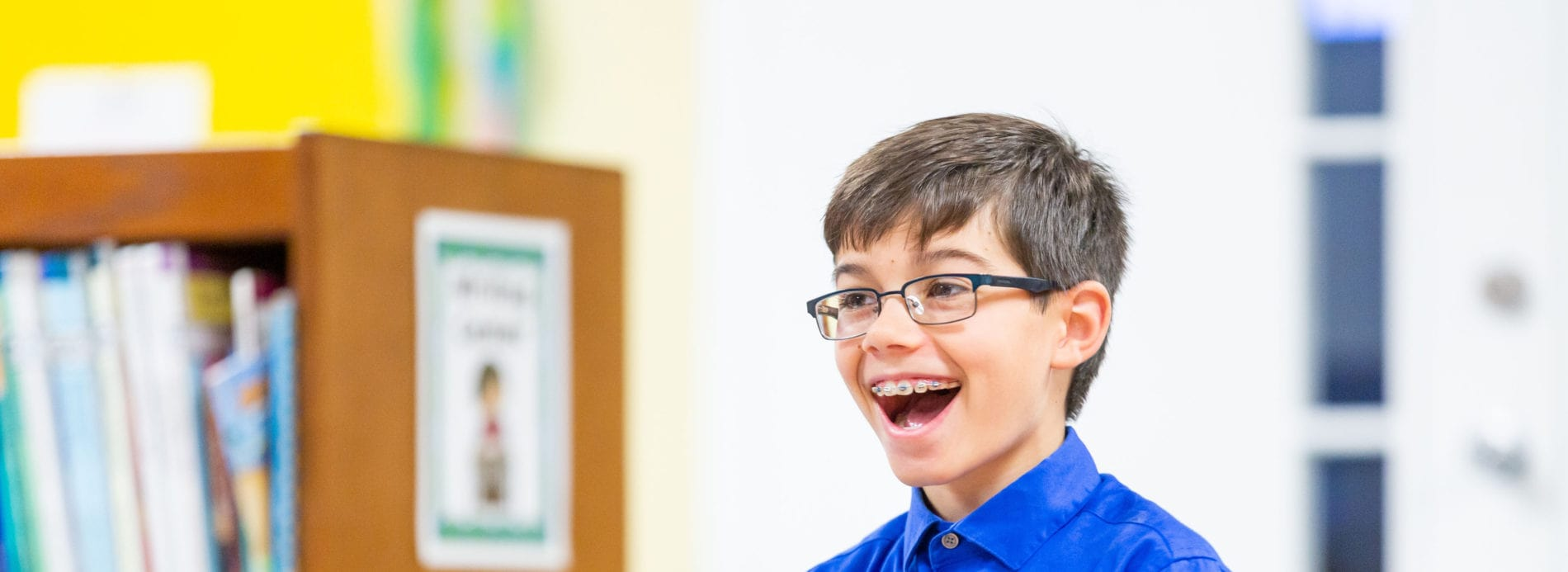 A boy smiles in surprise in Sunday School