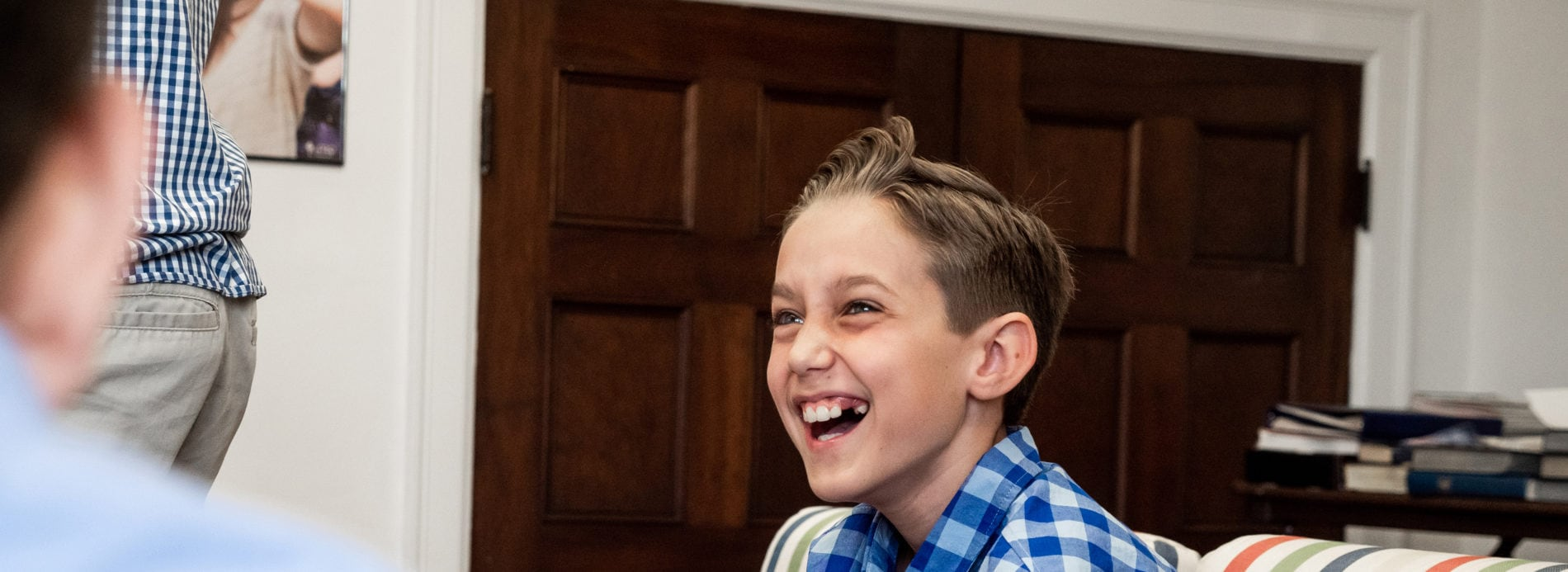 A boy smiles during middle school youth group