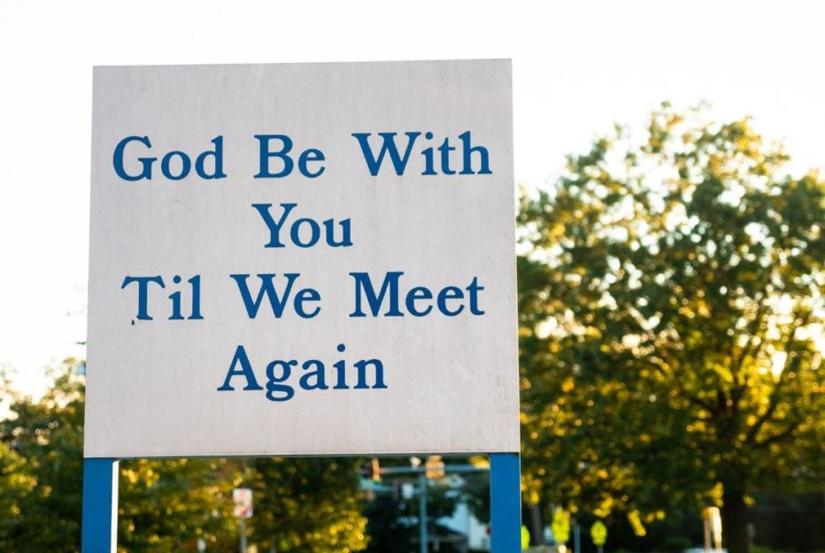 Sign saying God Be With You Til We Meet Again