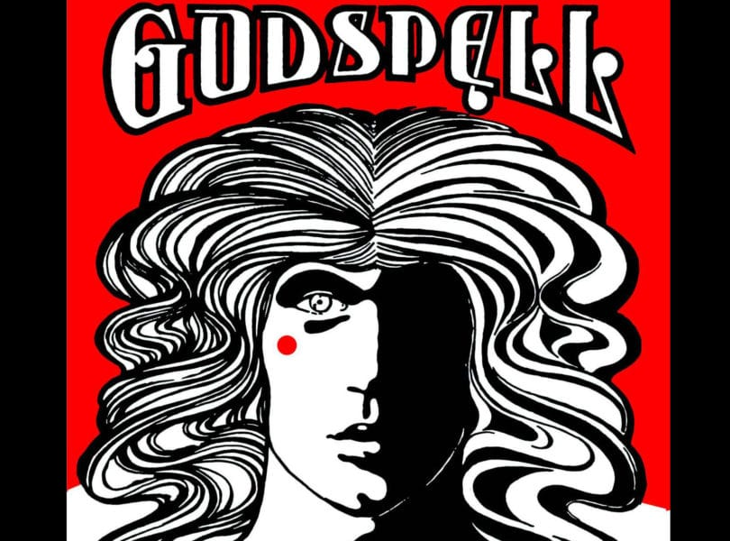 The GODSPELL playbill with a drawing of a person with flowing hair