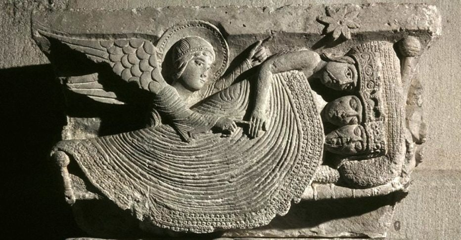 A stone engraving shows an angel directing the 3 wise men as they sleep