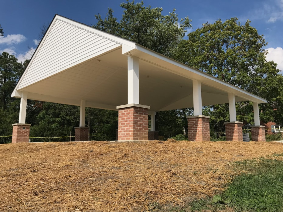 CPC's pavilion has a covered roof supported by columns with brick bases.